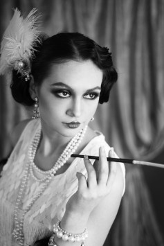 19032388 - beautiful young woman close up portrait in retro flapper style headband bw vogue style vintage